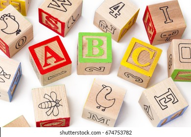 Toy blocks isolated on white spelling abc
