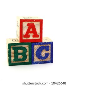 toy blocks with letters on a white background