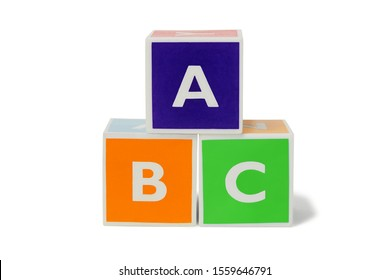Toy blocks with letters on white background