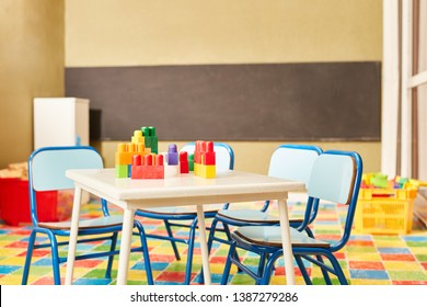 Toy blocks as a toy on a table in an empty room in the nursery