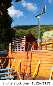 Toy boat at playground and royal castle on hill top in Visegrád, Hungary
