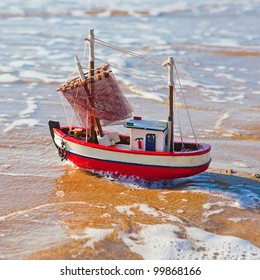toy boat in the sea waves