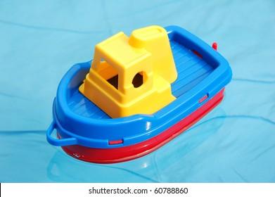 Toy boat in waterpool