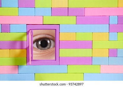 toy brick wall with window and eye