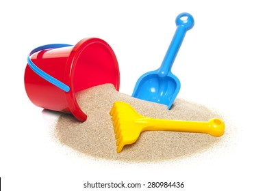 Toy bucket rake and spade isolated on white background