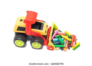 toy bulldozer with Old crayons isolated on white background