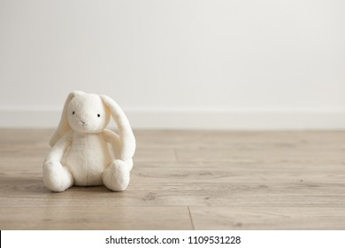 Toy bunny in the children's room. Background