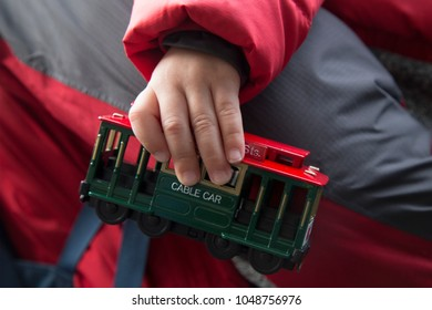 Toy of Cable car in Hand of a child