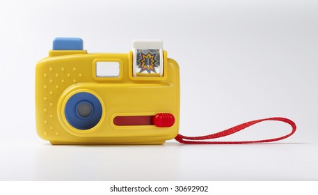 toy camera isolated on gray background