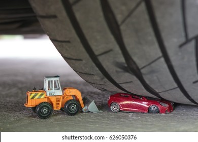 Toy car accident and digger help concept for background texture