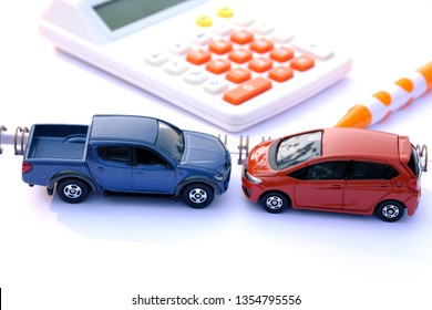 Toy car and calculator on white background. Vehicle insurance concept.