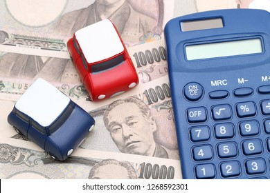 toy car and calculator with ten thousand japanese yen