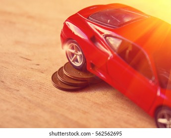 Toy car with coins closeup concept