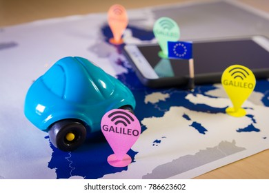 Toy car, Galileo pin and a smartphone Over a EU map.Symbolizing the European Galileo Global Satellite Navigation System GNSS.In April 2018,all new vehicles sold in Europe will be Galileo capable