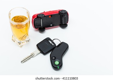 toy car and glass of whiskey metaphor crash accident isolated on white