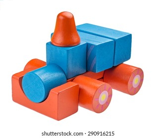 Toy car made from colored wooden blocks over white isolated background