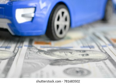 A toy car on money background