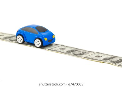 Toy car on money road isolated on white background