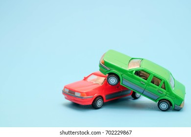 Toy cars in accident on a blue background