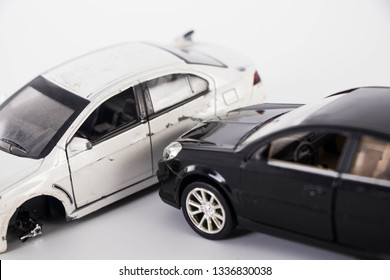 Toy cars collide on a white background