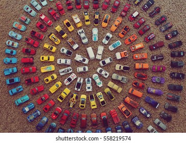 Toy cars making a colorful circle
