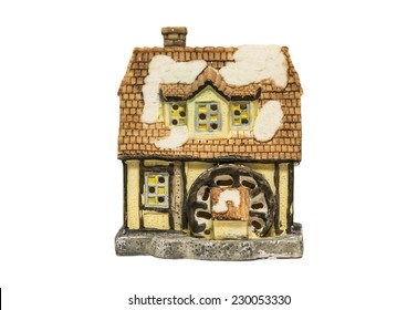 Toy ceramic house isolated on white