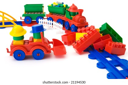 Toy colored railway and toy plastic machine