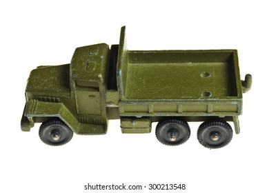 Toy copies of old military vehicles isolated on white background.