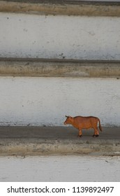 Toy cow on staircase