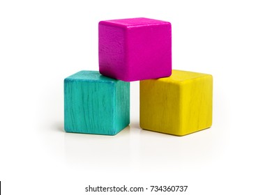 Toy Cube Blocks, CMYK Color Isolated over White Background, Three Kids Wood Toys, Cyan Magenta Yellow colors