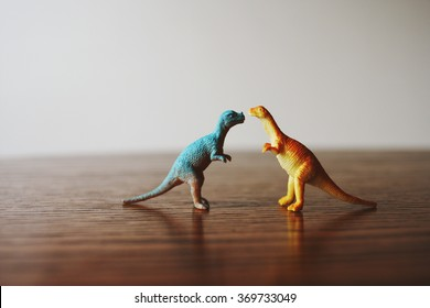 Toy dinosaurs on a table.