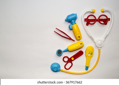 Toy doctor set on white background with space for text
