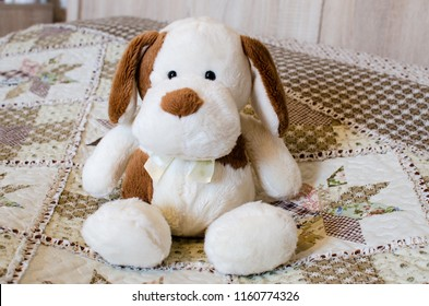 toy doggy on the bed