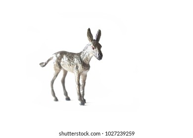 Toy donkey over a white background