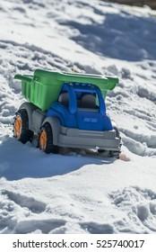 Toy Dump Truck in Snowy Mounds