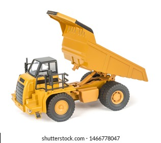 toy dump truck with upped open-box bed side view. Children's toy plastic haul truck car with isolated on white background