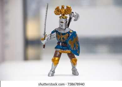 Toy figure of a knight with a sword and shield
