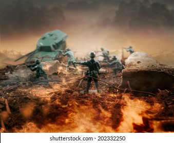 Toy fire war zone. Plastic toy attack war scene with soldiers, weapons and explosions with fire on front line and background.