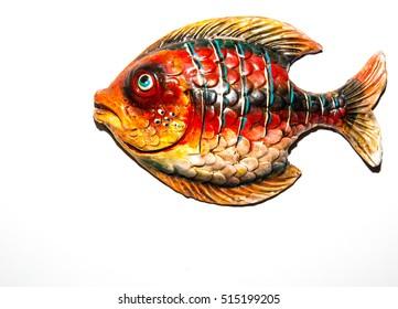 Toy fish on white background