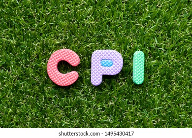 Toy foam letter in word CPI (abbreviation of Consumer Price Index) on green grass background