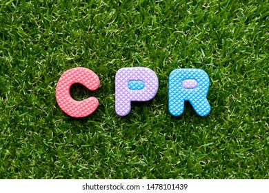 Toy foam letter in word CPR (abbreviation of Cardiopulmonary resuscitation) on green grass background