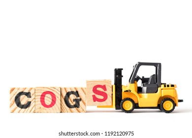 Toy forklift hold letter block s to complete word  COGS (Abbreviation of Cost of goods sold) on white background
