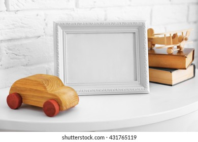 Toy with frame on white wall background