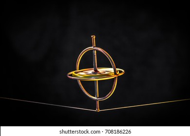 Toy gyroscope balancing on a line