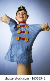 toy hand puppet against blue background