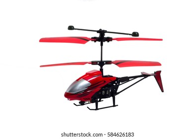 Toy helicopter with remote control in white isolated background.