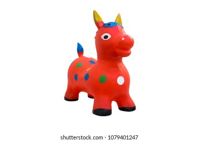 Toy horse red made of plastic isolated on white background