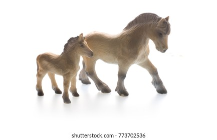 Toy horses, perspective from the front, isolated on white