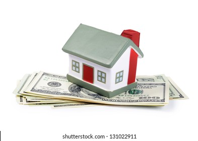 toy house for dollar banknotes as background