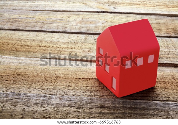 Toy House on Wooden Background